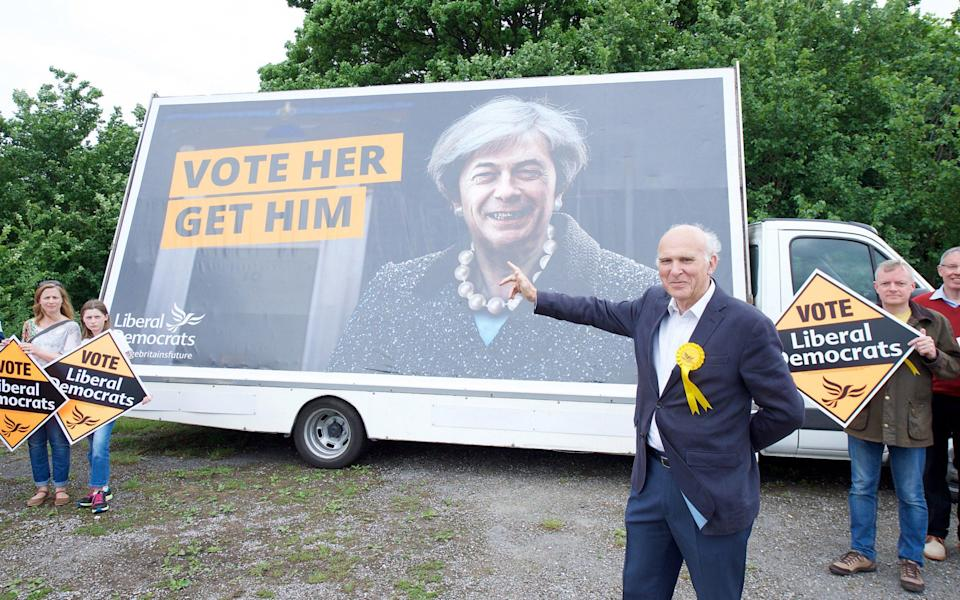 Vince Cable unveils a national poster to kick start the next stage of the Liberal Democrat general election campaign - Credit: Elliott Franks