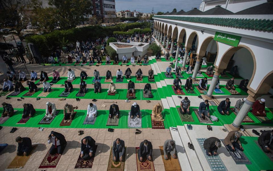 Muslim worshippers observe social distancing during Friday prayer. For the first time since the outbreak began in March, Morocco has allowed mosques to reopen for Friday prayers. - AP Photo/Mosa'ab Elshamy