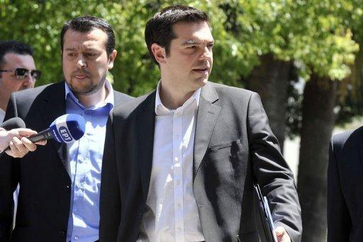 Radical left party leader Alexis Tsipras leaves the presidential palace in Athens
