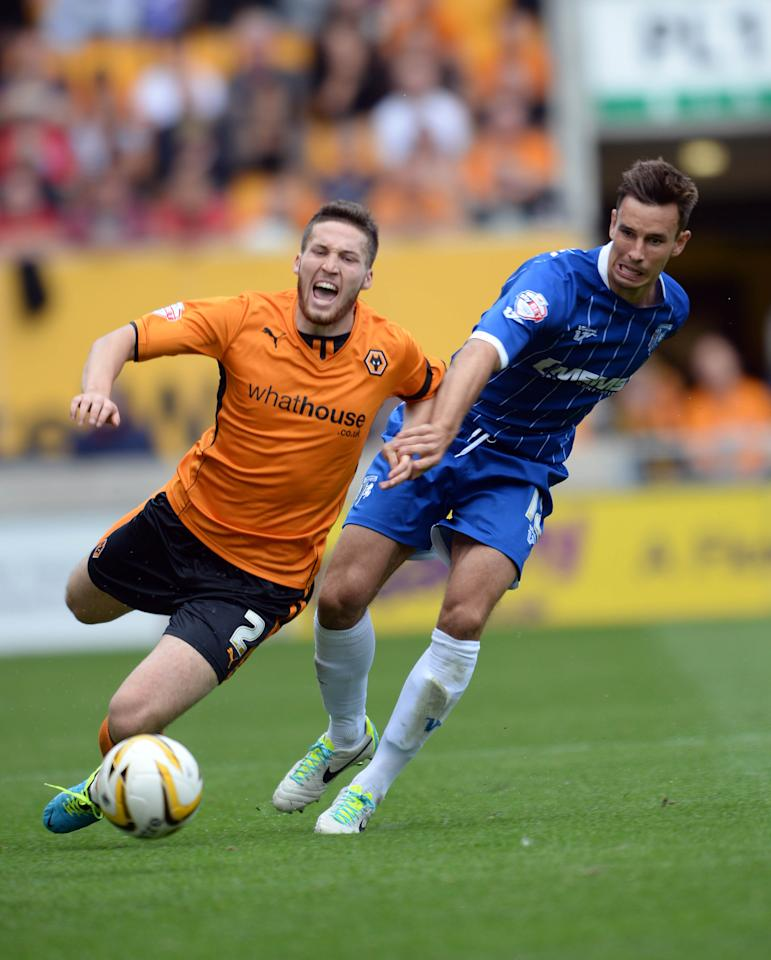 Wolves' Matt Doherty (left) and Gillingham's Steven Gregory battle for the ball during the Sky Bet League One match at the Molineaux, Wolverhampton.