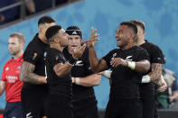 New Zealand' players celebrate a try during the Rugby World Cup quarterfinal match at Tokyo Stadium between New Zealand and Ireland in Tokyo, Japan, Saturday, Oct. 19, 2019. (AP Photo/Mark Baker)