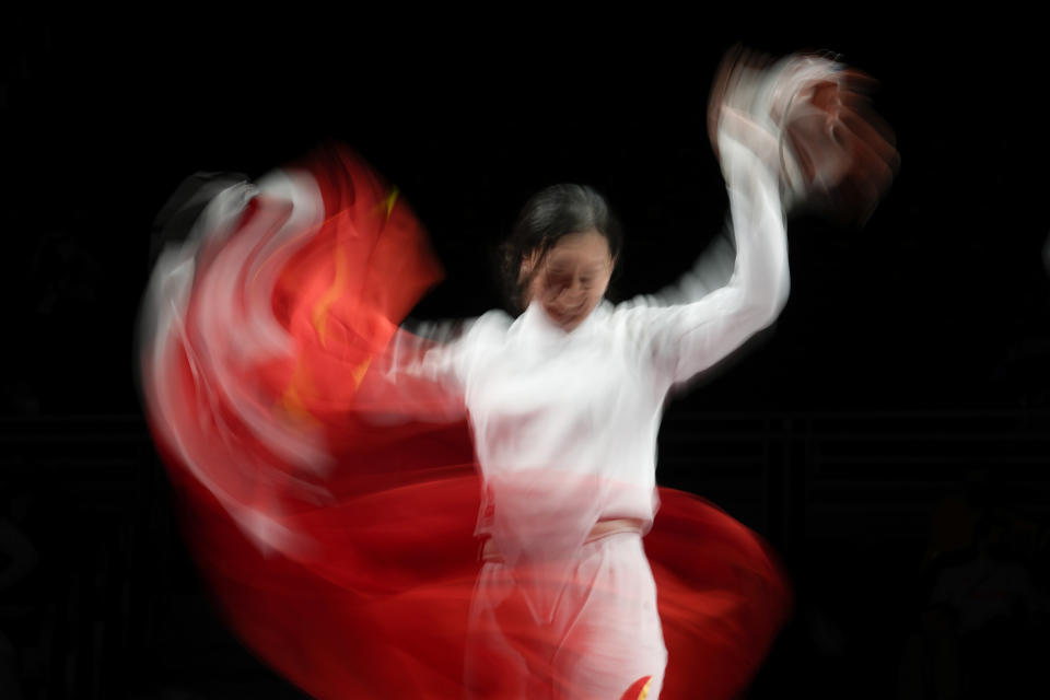 Sun Yiwen of China celebrates after winning the women's individual Epee final at the 2020 Summer Olympics, Saturday, July 24, 2021, in Chiba, Japan. (AP Photo/Andrew Medichini)