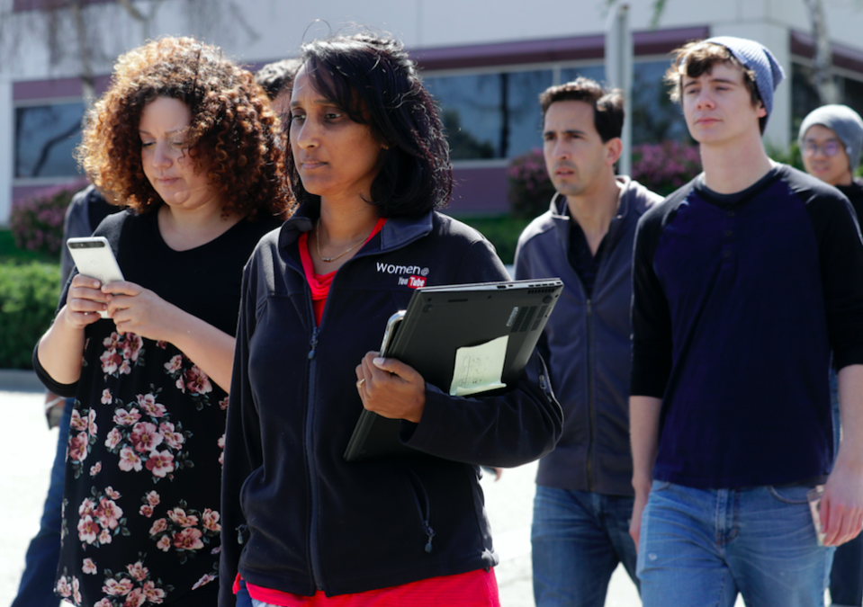 <em>Workers wait outside the YouTube complex for news (AP)</em>
