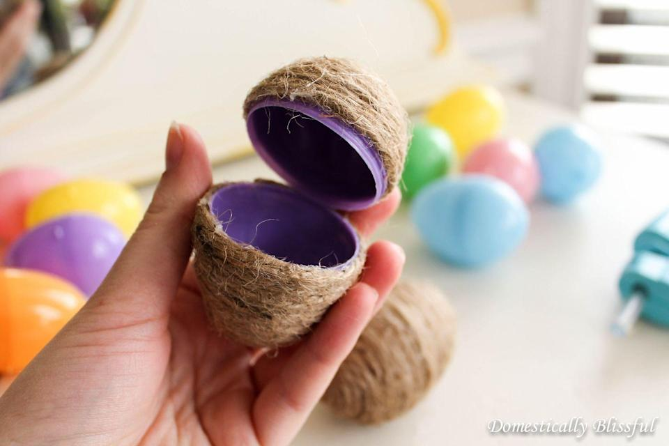 """<p>If bright, plastic Easter eggs stick out too much against your décor, this twine eggs might be harder to spot. Plus, you can use them as a rustic decoration before and after the hunt.</p><p><em><a href=""""https://domesticallyblissful.com/twine-eggs/"""" rel=""""nofollow noopener"""" target=""""_blank"""" data-ylk=""""slk:Get the twine egg tutorial at Domestically Blissful »"""" class=""""link rapid-noclick-resp"""">Get the twine egg tutorial at Domestically Blissful »</a></em></p>"""