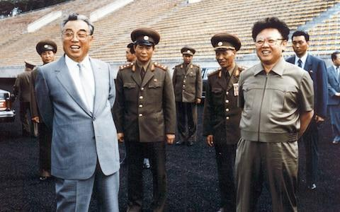 <span>Kim Il-sung (left) with his son and successor Kim Jong-il in Pyongyang in 1992</span> <span>Credit: AFP </span>