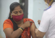 A health worker receives a COVID-19 vaccine at a government Hospital in Mumbai, India, Tuesday, Jan 19, 2021. India's homegrown vaccine developer Bharat Biotech has warned people with weaker immunity and other medical conditions that include allergies, fever, or a bleeding disorder to consult a doctor before getting the shot — and if possible avoid the vaccine. (AP Photo/Rafiq Maqbool)