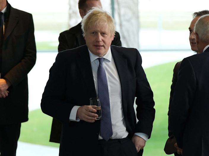 Johnson arrives for an international summit on securing peace in Libya in Berlin on Sunday: Getty