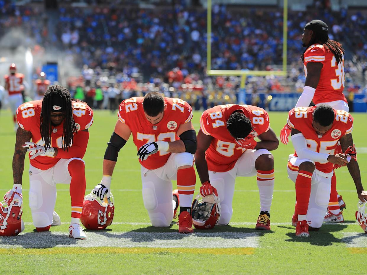 Terrance Smith #48, Eric Fisher #72, Demetrius Harris #84, and Cameron Erving #75 of the Kansas City Chiefs is seen taking a knee before the game against the Los Angeles Chargers at the StubHub Center on 24 September, 2017 in Carson, California: Sean M. Haffey/Getty