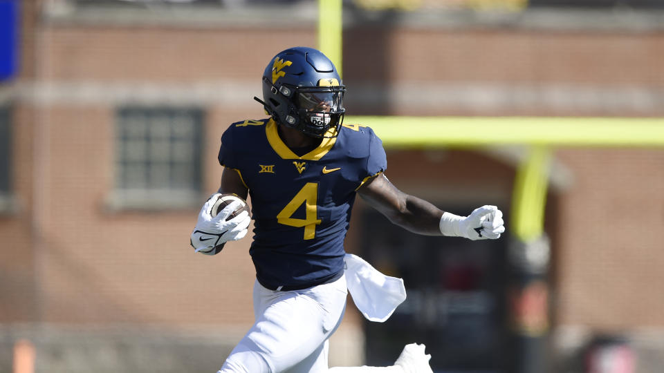 West Virginia running back Leddie Brown could be a good fit in an outside-zone run scheme. (AP Photo/Gail Burton)