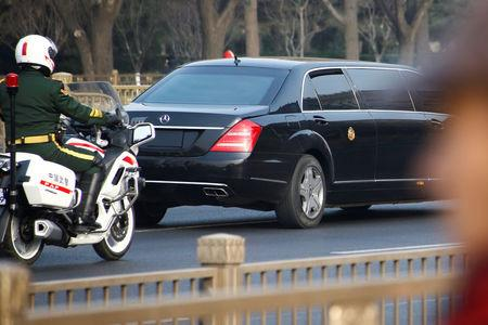 A vehicle that is part of a motorcade that is believed to be carrying North Korean leader Kim Jong Un makes its way through central Beijing