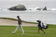 Jordan Spieth walks up the fourth fairway of the Pebble Beach Golf Links during the final round of the AT&T Pebble Beach Pro-Am golf tournament Sunday, Feb. 14, 2021, in Pebble Beach, Calif. (AP Photo/Eric Risberg)