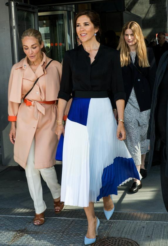<p>Princess Mary is a big fan of soft silk skirts and this block print one that she paired with baby blue heels and blue earrings is one of our favourite looks. Source: Getty </p>