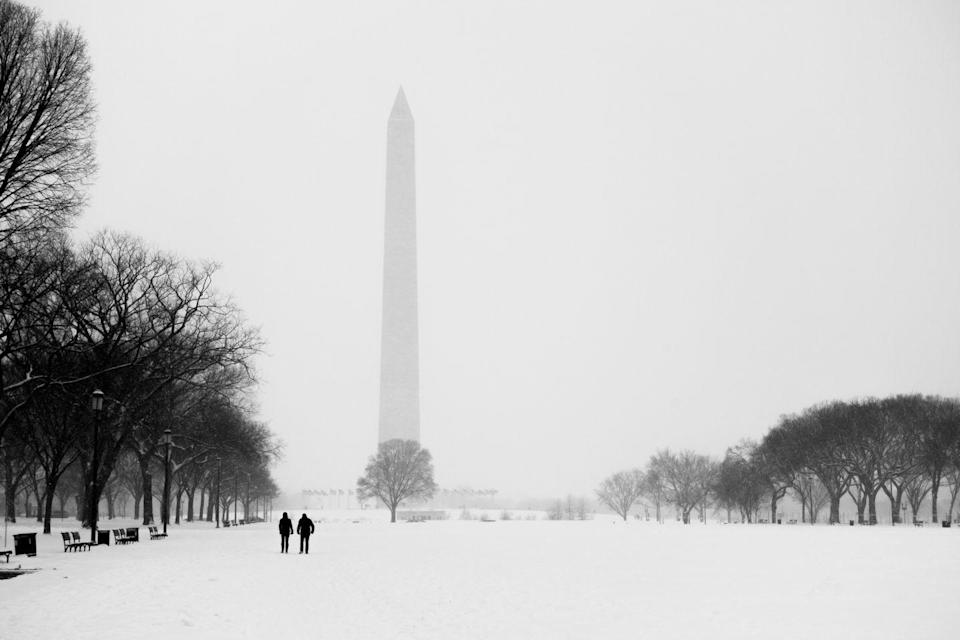 <p>The Washington Monument overlooks the snowy National Mall in the nation's capital.</p>