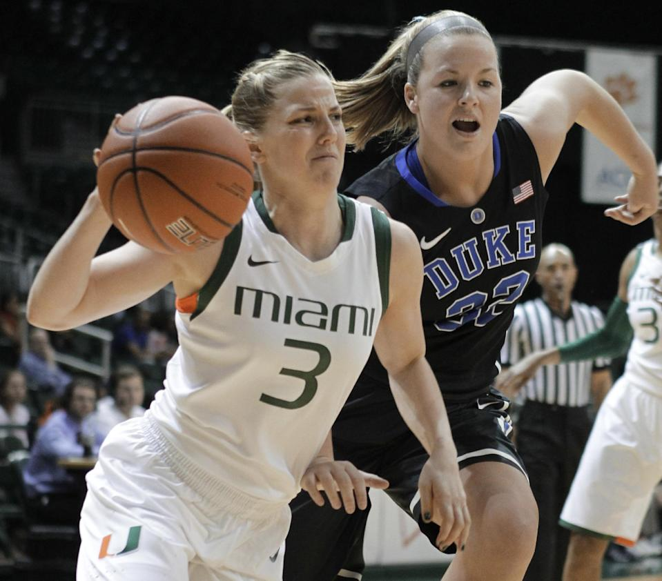 Miami's Stefanie Yderstrom (3) moves the ball as Duke's Tricia Liston (32) defends during the first half of an NCAA college basketball game in Coral Gables, Fla., Thursday, Feb. 28, 2013. (AP Photo/Luis M. Alvarez)