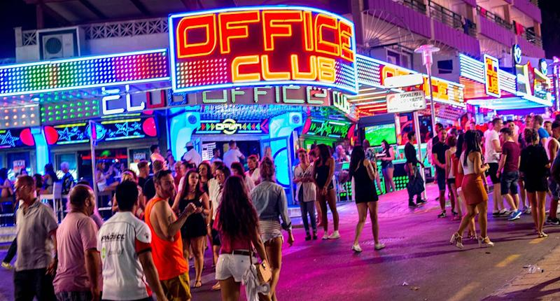 "Tourists are seen enjoying the atmosphere of a local bar on Punta Ballena Street, also known as ""the strip"" in Mallorca, Spain. Magaluf is one of the Britain's favorite holiday destinations popular because of it's beautiful beaches, bars, and active nightlife. (Photo by David Ramos/Getty Images)"