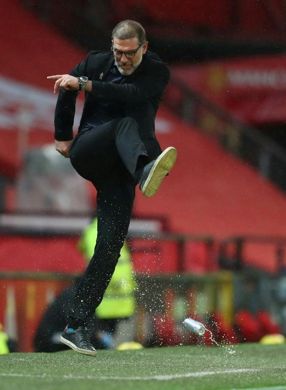 West Bromwich Albion manager Slaven Bilic takes out his frustration on a water bottle after his side's misfortune in losing 1-0 to Manchester United