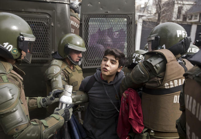 <p>A high school student is detained during a protest for education reform in Santiago, Chile, July 28, 2016. Protesters demands include free access to school for all ages, including university level. (Photo: Esteban Felix/AP)</p>