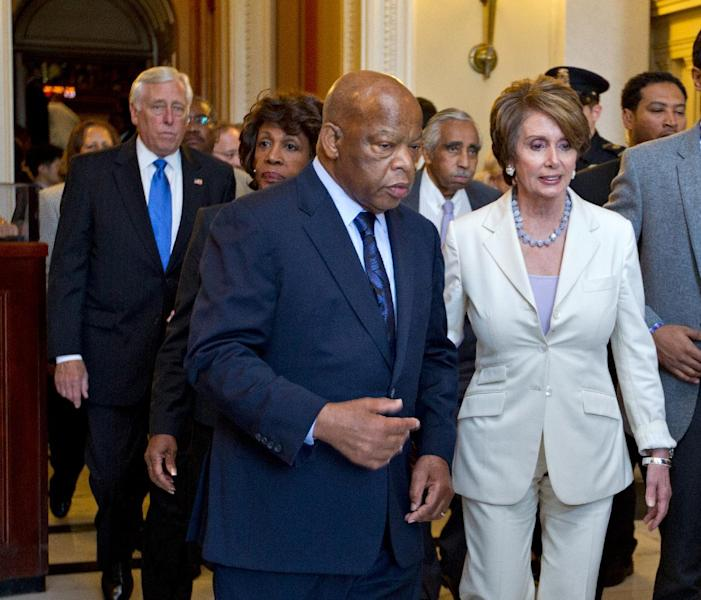 From left, House Minority Whip Steny Hoyer of Md., Rep. Maxine Waters, D-Calif., Rep. John Lewis, D-Ga., Rep, Charles Rangel, D-N.Y., and House Minority Leader Nancy Pelosi of Calif., right, and many House Democrats walk out of the Capitol during the vote to hold Attorney General Eric Holder in contempt, Thursday, June 28, 2012, on Capitol Hill in Washington. (AP Photo/J. Scott Applewhite)