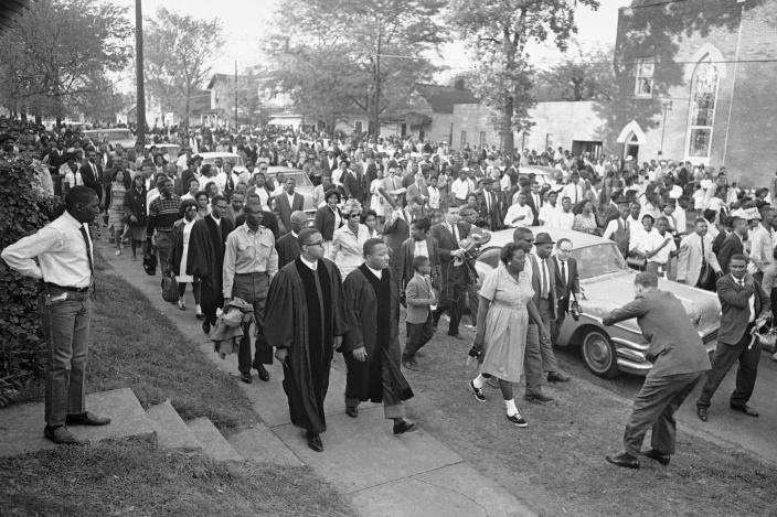 FILE - In this April 14, 1963 file photo, two ministers lead protest marchers in a civil rights demonstration in Birmingham, Ala., which was later broken up by police. The U.S. civil rights movement of the 1950s and 1960s achieved monumental changes over a 15-year period, including landmark federal laws. Yet racism and discrimination remain pervasive problems in 2020. (AP Photo/Horace Cort)
