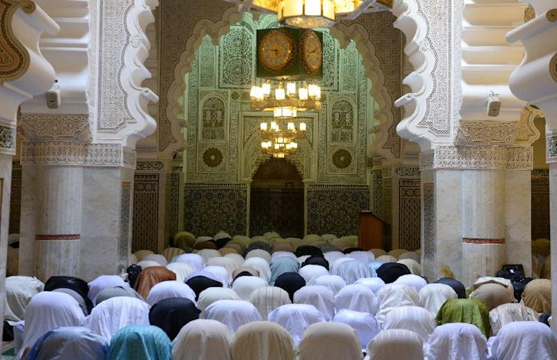 Members of the Tijaniyya Brotherhood pray as they take part in a remembrance for Sheikh Sidi Ahmed al-Tijani who lived during the eighteenth century on May 14, 2014 in the Moroccan city of Fez