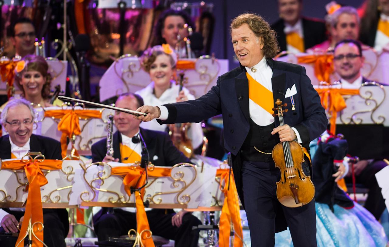 AMSTERDAM, NETHERLANDS - APRIL 30: Andre Rieu performs on stage at Museumplien during the inauguration of King Willem Alexander of the Netherlands as Queen Beatrix of the Netherlands abdicates on April 30, 2013 in Amsterdam, Netherlands. (Photo by Ian Gavan/Getty Images)