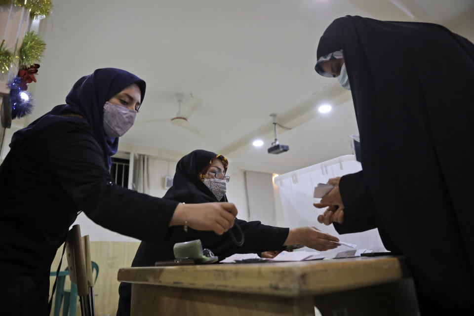 Election officials count ballots for the presidential elections at a polling station in Tehran, Iran, early Saturday, June 19, 2021. Iranians voted Friday in a presidential election dominated by Supreme Leader Ayatollah Ali Khamenei's hard-line protege after the disqualification of his strongest competition, fueling apathy that left some polling places largely deserted despite pleas to support the Islamic Republic at the ballot box. (AP Photo/Vahid Salemi)