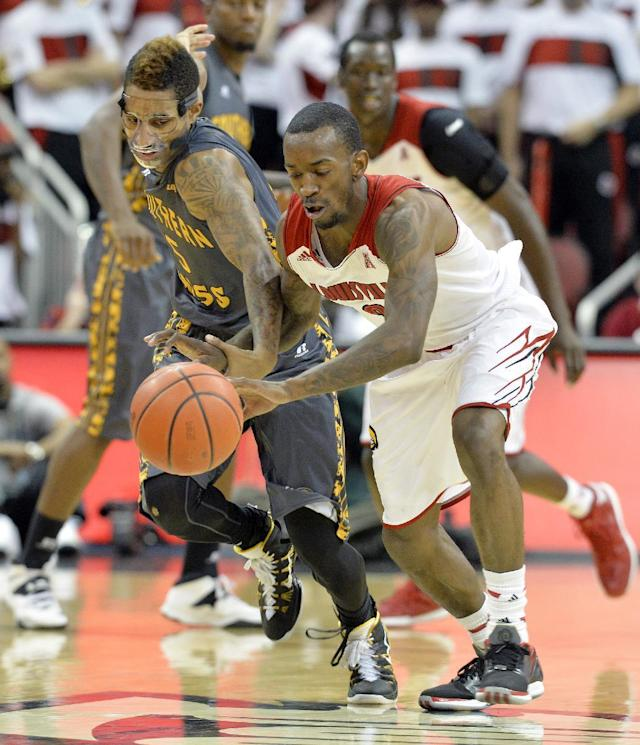 Louisville's Russ Smith, front, battles Southern Mississippi's Nell Watson for a loose ball during the second half of an NCAA college basketball game Friday, Nov. 29, 2013, in Louisville, Ky. Louisville won 69-38. (AP Photo/Timothy D. Easley)