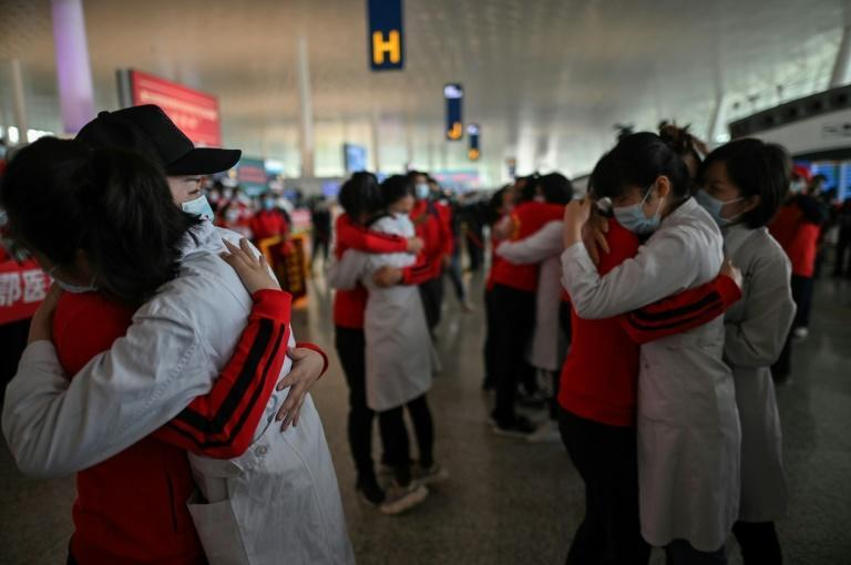 Medical staff hug nurses in Wuhan in April 2020 before they leave the city after working on the Covid-19 outbreak. The image was captured by Hector Retamal, who won first prize in the Excellence in Photography category at the 2021 SOPA awards