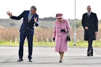 Britain's Queen Elizabeth II (C) speaks with Dstl Chief Executive Gary Aitkenhead (L) as she arrives at the Energetics Analysis Centre as they visit the Defence Science and Technology Laboratory (Dstl) at Porton Down science park near Salisbury, southern England, on October 15, 2020. - The Queen and the Duke of Cambridge visited the Defence Science and Technology Laboratory (Dstl) where they were to view displays of weaponry and tactics used in counter intelligence, a demonstration of a Forensic Explosives Investigation and meet staff who were involved in the Salisbury Novichok incident. Her Majesty and His Royal Highness also formally opened the new Energetics Analysis Centre. (Photo by Ben STANSALL / POOL / AFP) (Photo by BEN STANSALL/POOL/AFP via Getty Images)
