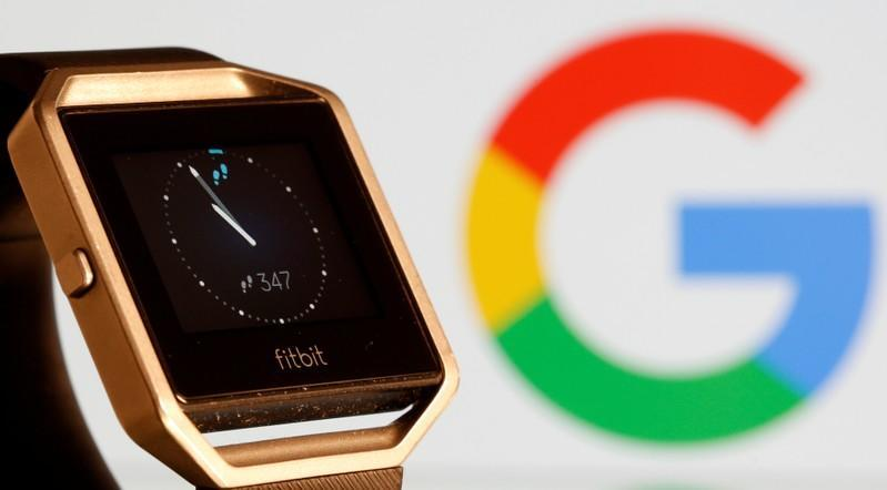 Fitbit Blaze watch is seen in front of a displayed Google logo in this illustration