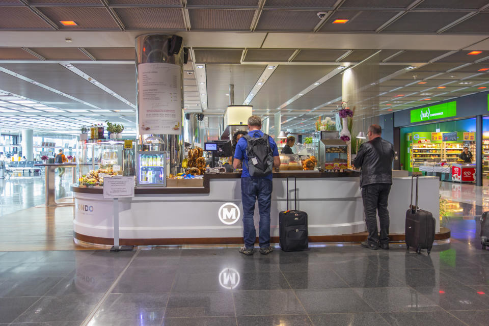Frankfurt, Germany - October 10 2018: People shopping at an airport cafeteria