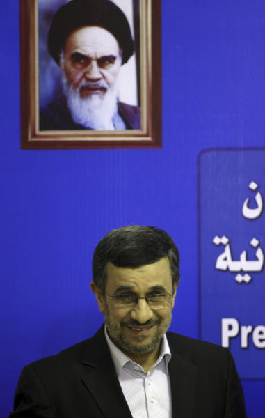 Iran's President Mahmoud Ahmadinejad smiles to journalists as he arrives to the press conference in Cairo, Egypt, Thursday Feb. 7, 2013. (AP Photo/Khalil Hamra)