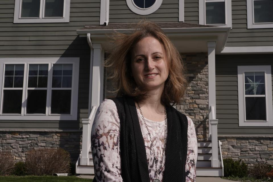 Jana Elkadri poses for a picture outside her Brookfield, Wis., home April 23, 2021. (AP Photo/Morry Gash)