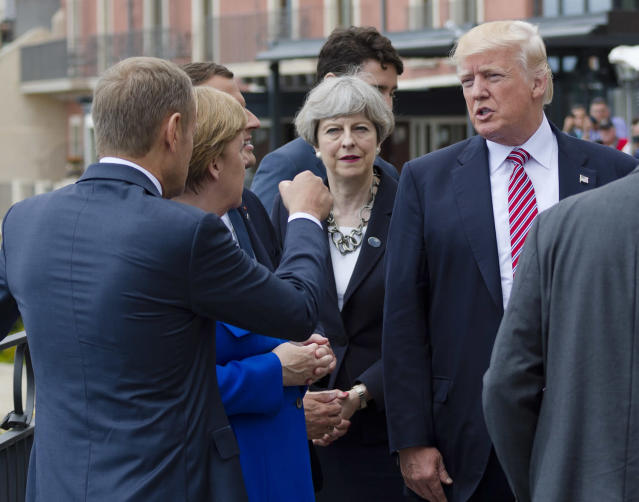 <p>From left, President of the European Council Donald Tusk gesticulates as he talks with German Chancellor Angela Merkel, French newly elected President Emmanuel Macron, partially hidden, British PM Theresa May, and US President Donald Trump before the start of the G-7 summit in the Sicilian town of Taormina, Italy, May 26, 2017. (Photo: Salvatore Cavalli/AP) </p>