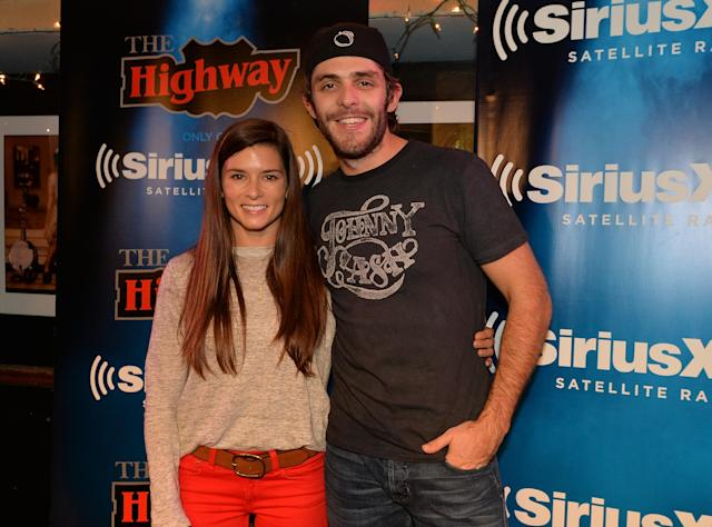 NASHVILLE, TN - OCTOBER 23: (EXCLUSIVE COVERAGE) NASCAR Driver Danica Patrick and Singer/Songwriter Thomas Rhett pose after a taping of SiriusXM The Highway VIP Performance featuring Thomas Rhett and special guest his dad Singer/Songwriter Rhett Akins at the Bluebird Cafe on October 23, 2013 in Nashville, Tennessee. (Photo by Rick Diamond/Getty Images)