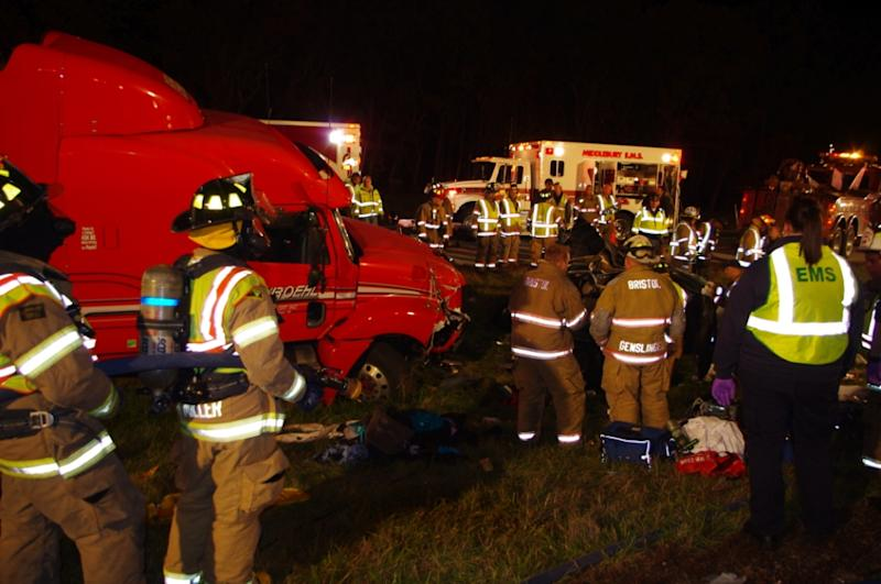 A photo released by the INdiana State Police show firemena nd EMS workers at the scene of a fatal accident on sthe Indiana Toll Road near Bristol, Ind. Thursday Oct. 27, 2011.   A tractor-trailer slammed into the back of a minivan in northern Indiana killing at least seven people and sending four other to hospitals, authorities said.  (AP Photo/Indiana State Police)