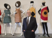 FILE - In this Nov.13, 2014 file photo, French fashion designer Pierre Cardin poses with dresses behind during the inauguration of the Pierre Cardin Museum in Paris. France's Academy of Fine Arts says Pierre Cardin, the French designer whose Space Age style was among the iconic looks of 20th-century fashion, has died at 98. (AP Photo/Jacques Brinon, File)