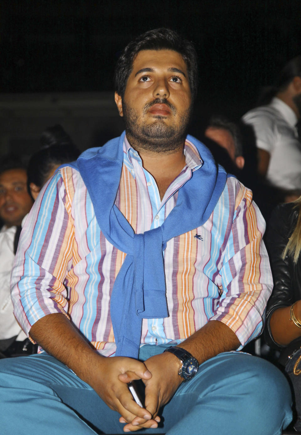Turkish-Iranian businessman Reza Zarrab, charged in the U.S. for evading sanctions on Iran, watches a concert in Istanbul on Sept 8, 2013. (Photo: Depo Photos via AP)