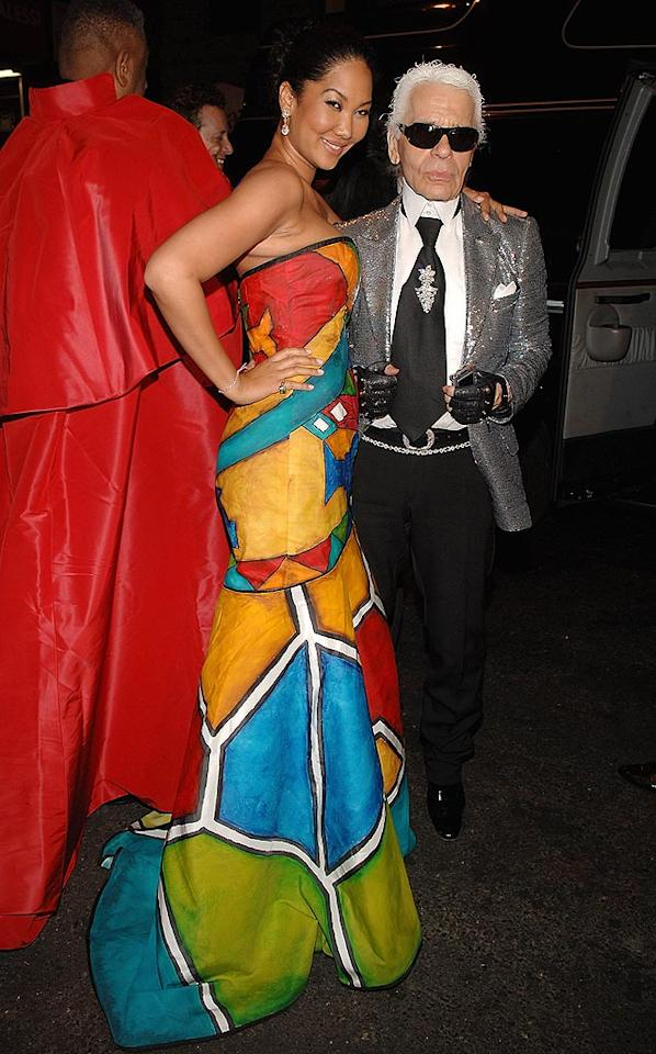 "To be perfectly honest, we're not at all surprised to see entrepreneur Kimora Lee Simmons and designer Karl Lagerfeld dressed as a gigantic Rubik's cube and an ancient disco ball. Jamie McCarthy/<a href=""http://www.wireimage.com"" target=""new"">WireImage.com</a> - May 5, 2008"