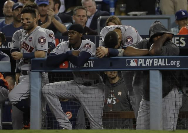 The Astros look on during the ninth inning of the Game 6. (AP)