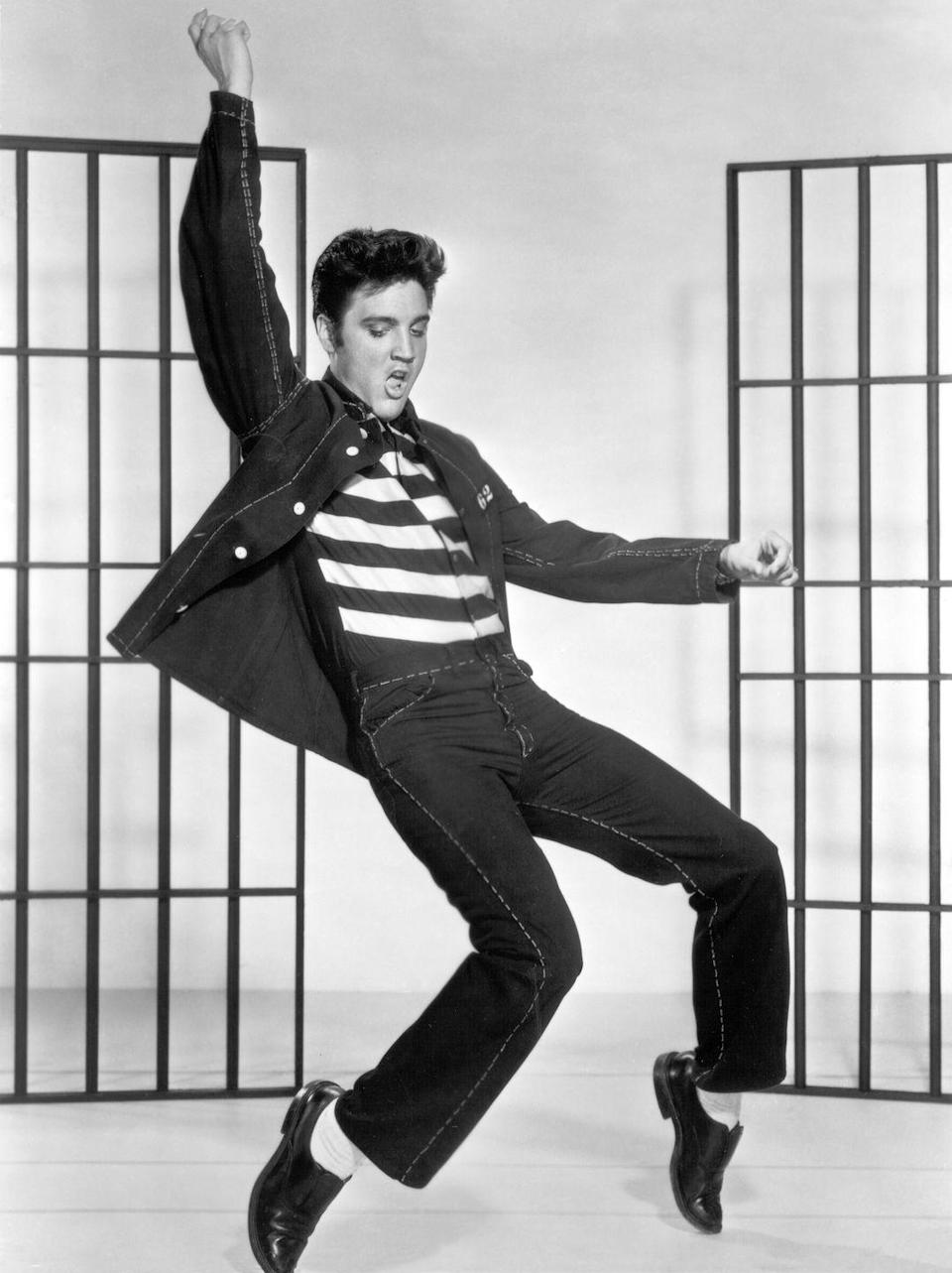 """<p>One of Presley's most famous songs was """"Jailhouse Rock,"""" which he recorded for the 1957 film of the same title. Here, he poses for a promotional shoot for the movie.</p>"""