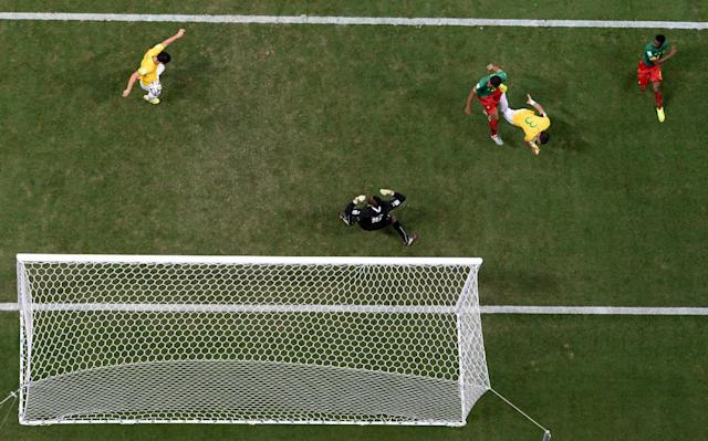 Brazil's Fred, left, scores his side's third goal during the group A World Cup soccer match between Cameroon and Brazil at the Estadio Nacional in Brasilia, Brazil, Monday, June 23, 2014. (AP Photo/Francois Xavier Marit, pool)