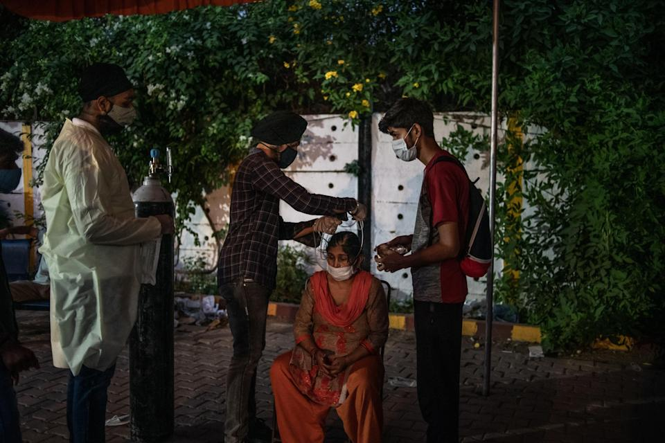 <p>Volunteers treat patients at a makeshift clinic in New Delhi</p> (Getty Images)