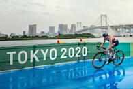 Great Britain's Georgia Taylor-Brown tackles the weather en route to winning silver in the women's triathlon.