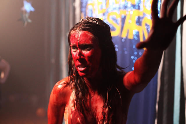 Carrie gets doused with fake (we hope) pig blood at Fox's Horror Rewind installation. (Photo: Yahoo)