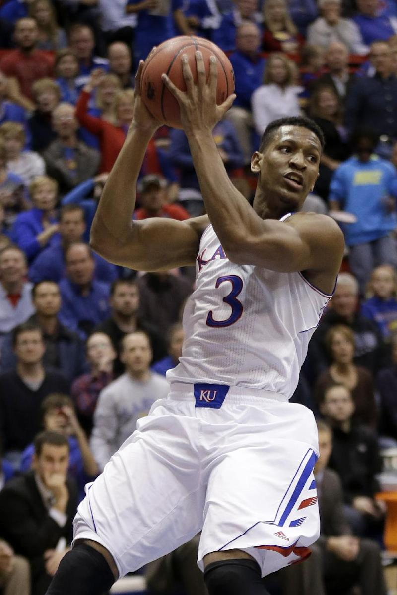 Kansas forward Andrew White III leaving program
