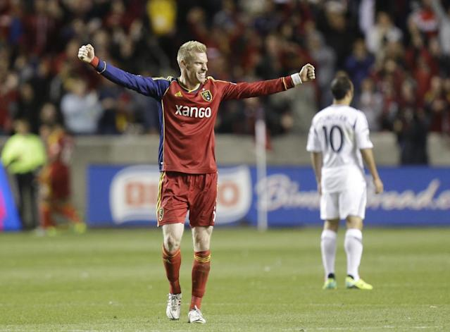 Los Angeles Galaxy's Landon Donovan (10) looks away as Real Salt Lake defender Nat Borchers (6) celebrates after his team scores in the first half during the second leg of the MLS Western Conference semifinal soccer game, Thursday, Nov. 7, 2013, in Sandy, Utah. (AP Photo/Rick Bowmer)