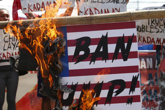 <p>Protesters, who have been camping out near the Presidential Palace for days, set on fire to a mock U.S. flag during a rally to protest a planned visit to the country of President Donald Trump Tuesday, Nov. 7, 2017 in Manila, Philippines.(Photo: Bullit Marquez/AP) </p>