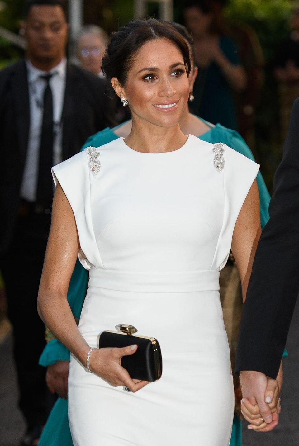"""<p>During the Prince Harry and Meghan's Royal Tour to Australia, Fiji, Tonga, and New Zealand, the Duchess wore her late mother-in-law's exquisite aquamarine ring in quiet tribute. <em><a href=""""https://www.townandcountrymag.com/style/jewelry-and-watches/a24216489/meghan-markle-princess-diana-aquamarine-cocktail-ring-tonga/"""" rel=""""nofollow noopener"""" target=""""_blank"""" data-ylk=""""slk:Town & Country"""" class=""""link rapid-noclick-resp"""">Town & Country</a> </em>reports the ring was part of a set that Diana wore many times.</p>"""