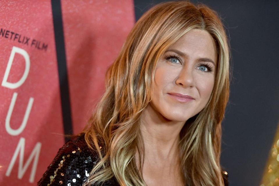 Aniston smiling at a netflix event